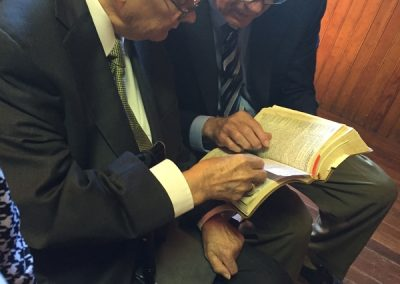Dr. Robert Sloan studying scripture with Col. Newt Cole in Tincup, Colorado