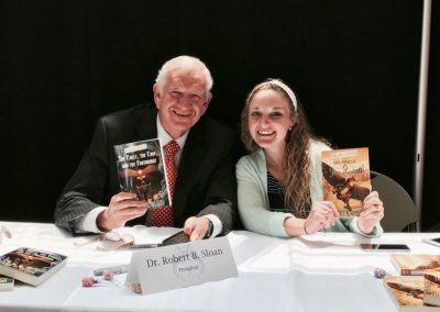 Robert B. Sloan and a university employee with Hamelin Stoop books 1 and 2