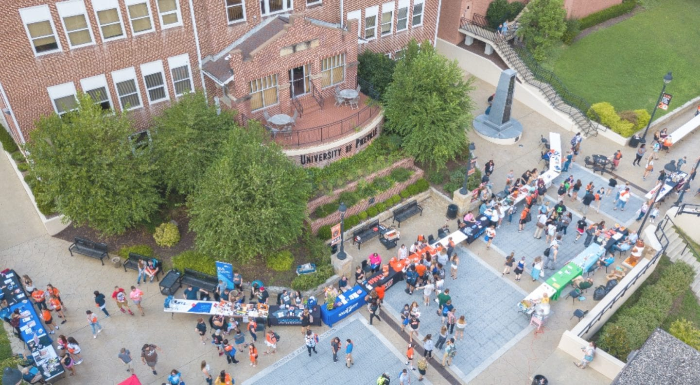 Aerial drone shot of benefactors plaza during the annual welcome week street fair