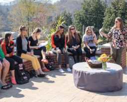 Class meeting outside at the president's firepit.