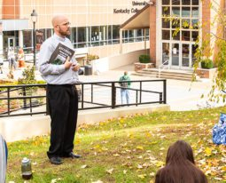Chaplain teaching class outside.
