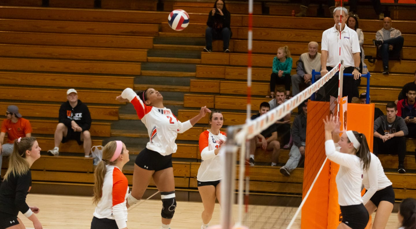 UPIKE volleyball player Noelani Simpson spikes the ball during a 2018 game.