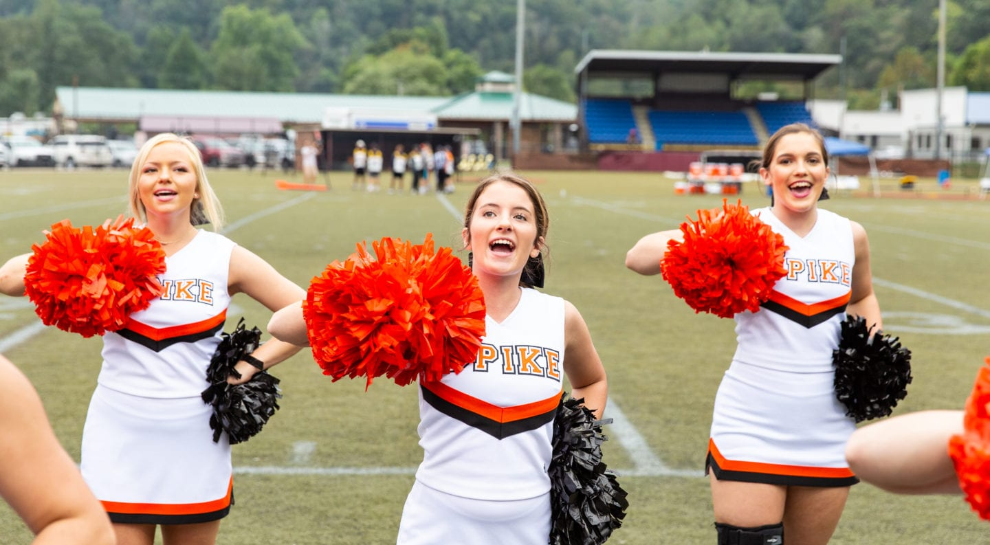 UPIKE cheerleader Autumn Chaney cheers on the football with fellow cheerleaders.