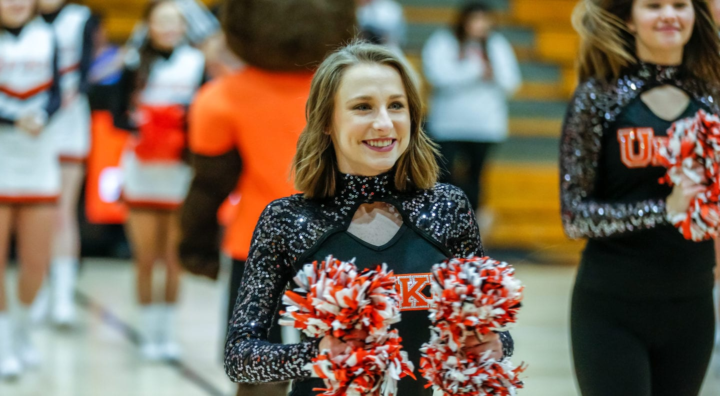 UPIKE dance team member Rachel Miller dancing at a basketball game