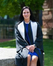 UPIKE criminal justice alumnus Ashley Cook sits on campus before commencement