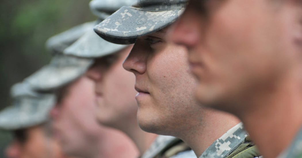 UPIKE ARMY ROTC students lined up on campus for a photoshoot during flag raising ceremony