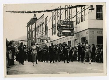 historic photo of the UPIKE band during a downtown parade