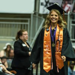 nursing student walking across stage during commencement