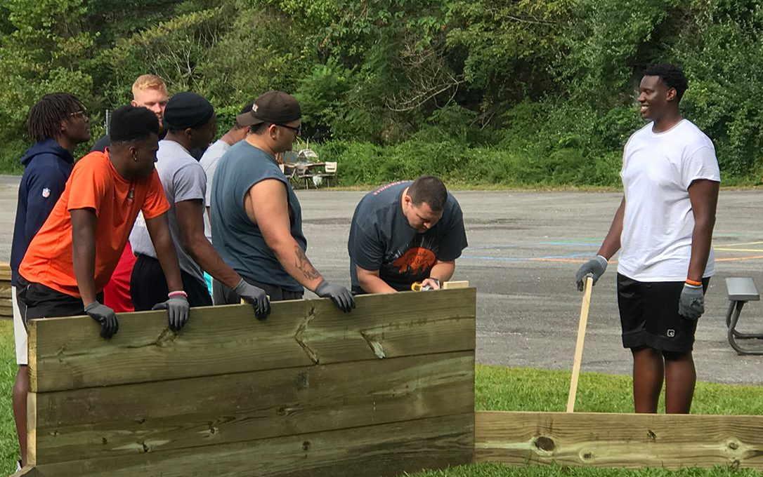 Students working on an elementary school playground for Service Day.