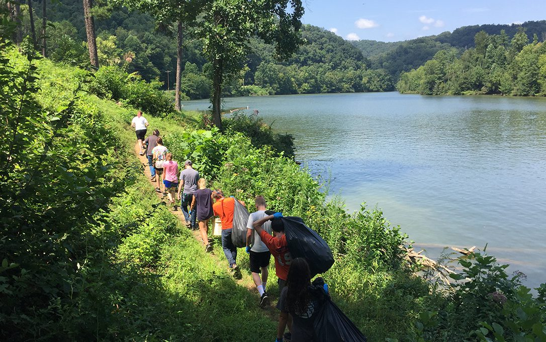 Students cleaning up the Pikeville Pond on Service Day.