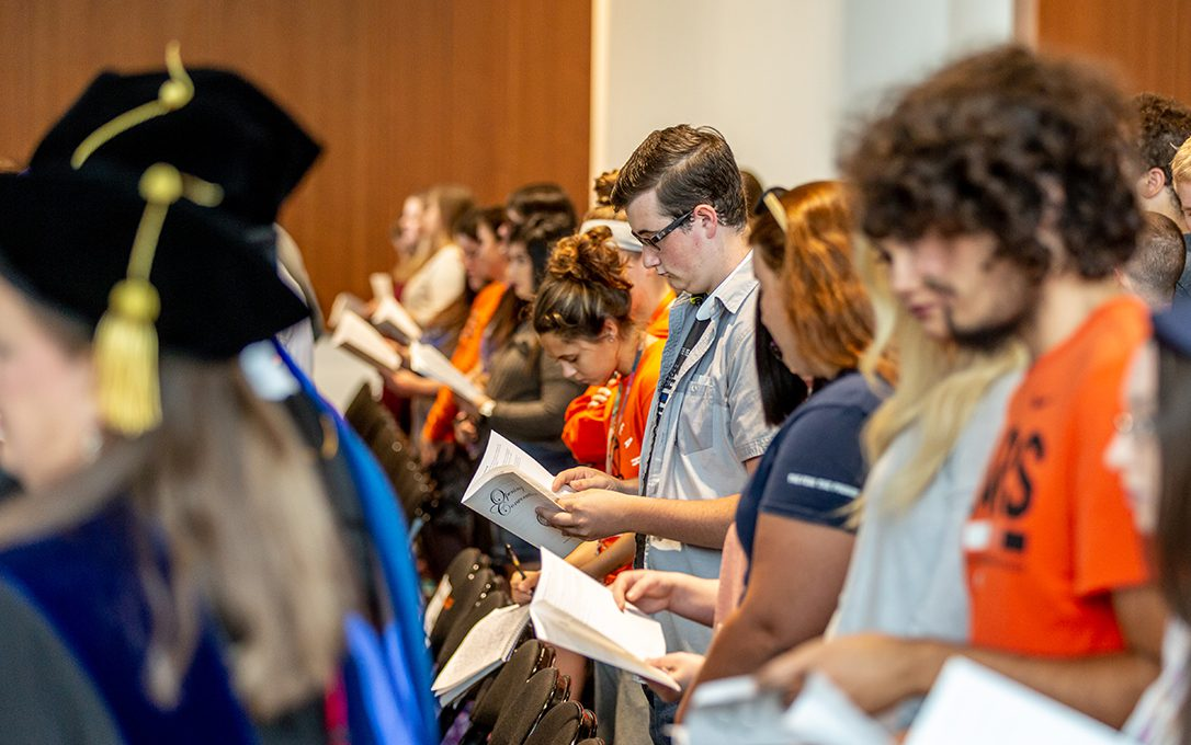 Students reading the litany during Opening Convocation.