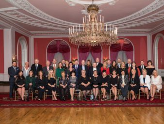 a group portrait of alumni and friends seated at the greenbriar in west virginia.