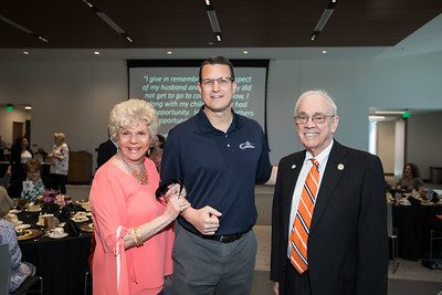 Paul and Judi Patton with UPIKE Athletic Director and Men's Basketball Head Coach Kelly Wells