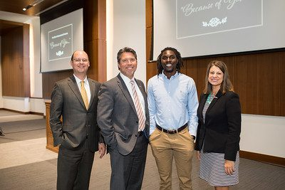 VP for Advancement David Hutches, President Burton J. Webb, UPIKE student Cheikh Ndaiye, and Provost Lori Werth