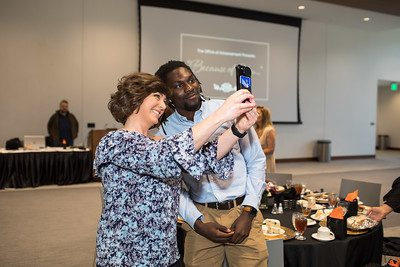 Associate Director of Advancement and Alumni Relations Lisa Blackburn poses for a selfie with UPIKE student Cheikh Ndaiye