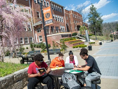 Students studying on Benefactors Plaza.