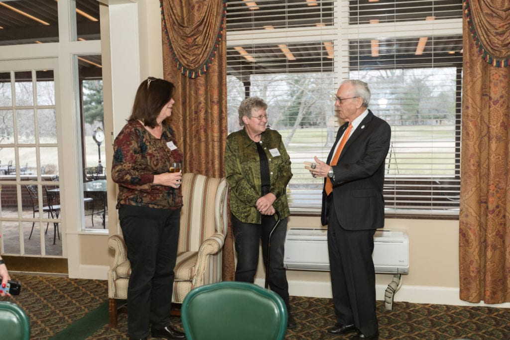 UPIKE Chancellor talking with guests