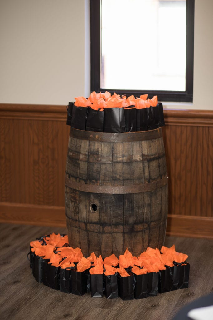 gifts on top of bourbon barrel