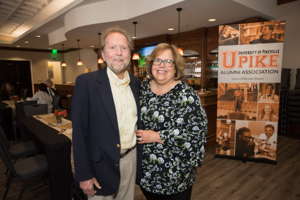 couple in front of the UPIKE banner
