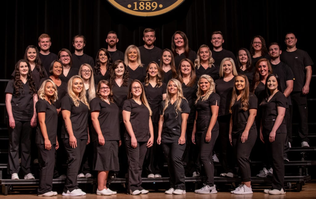 2019 nursing graduates pose for group photo during their pinning ceremony