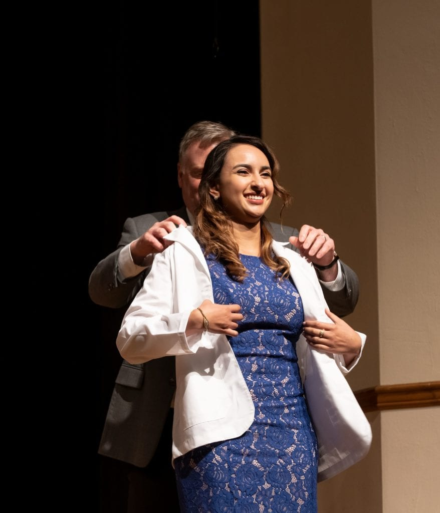 Sandra Maria Rugama, University of Pikeville-Kentucky College of Optometry student, receives her symbolic white coat signifying her entry into clinical training.