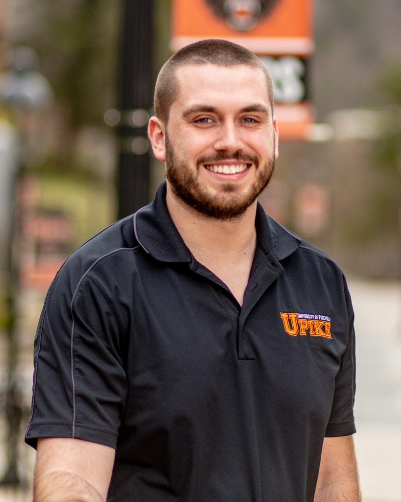 headshot of corey gannon, admissions assistant director of admissions