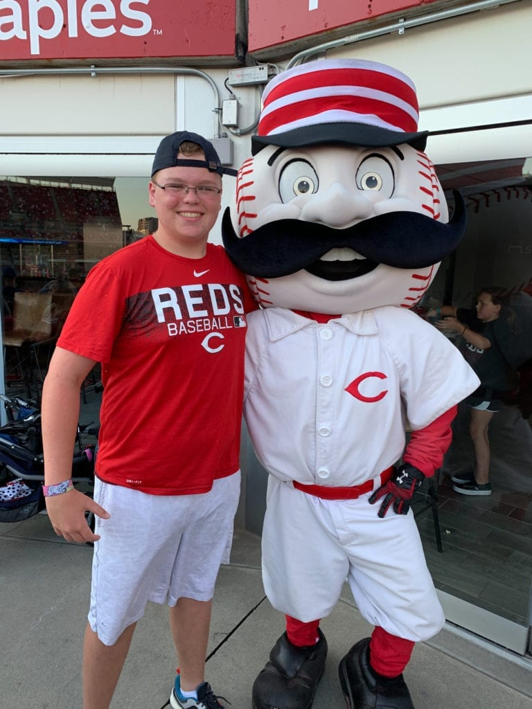 Event attendees enjoys visit with Reds mascot