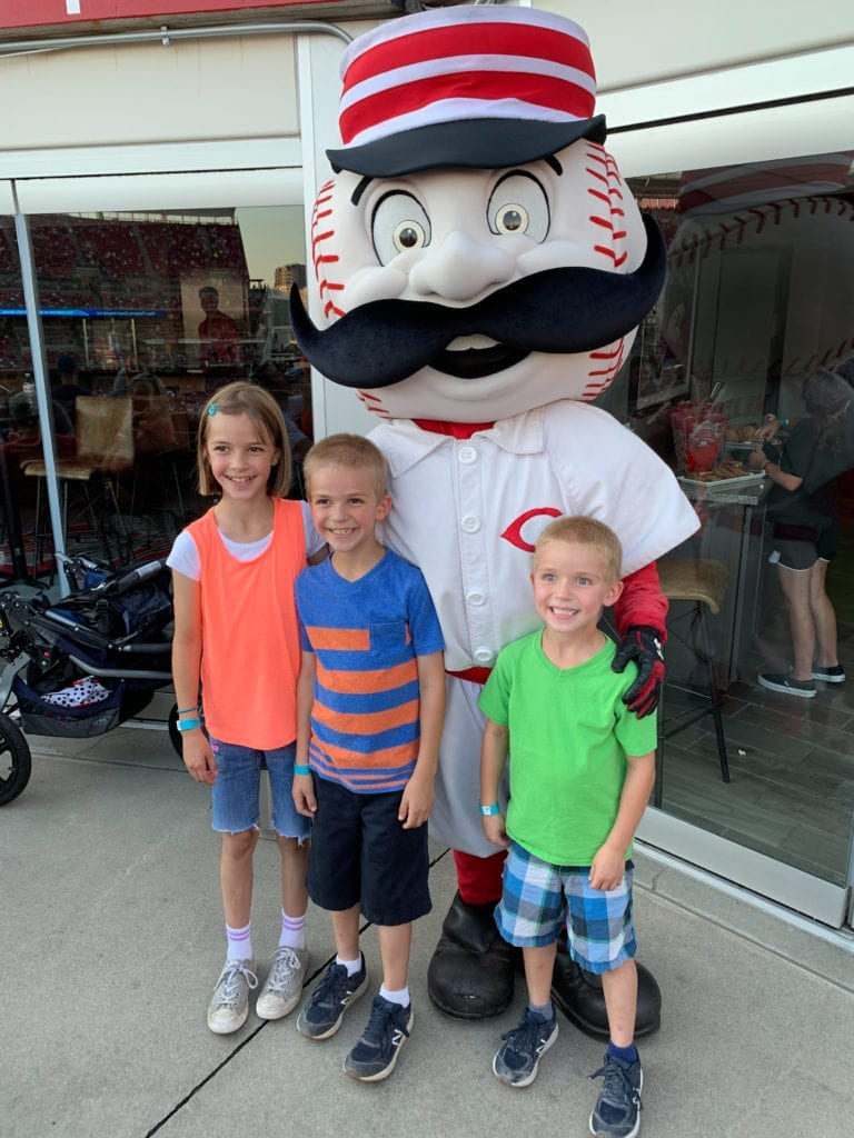 Three young fans with mascot