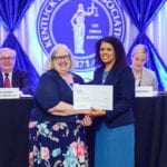 Allison J. Donovan, KBF secretary-treasurer for fiscal year 2018-2019, right, presents a check to Nancy Cade, Ph.D., during the Kentucky Bar Foundation Fellows & Partners for Justice Society Luncheon, held Thursday, June 13 in Louisville.