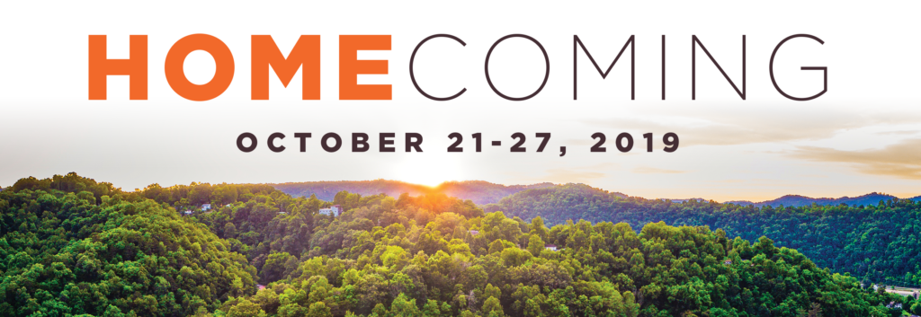 "Sunrise over the mountains with the words ""Homecoming. October 21-28, 2019"" above."
