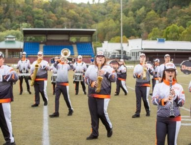 UPIKE marching band performing at a UPIKE football game