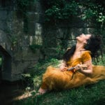 A Midsummer Night's Dream character playing next to a bridge