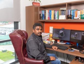 Dr. Jesson Martin seated at his desk for virtual optometry camp