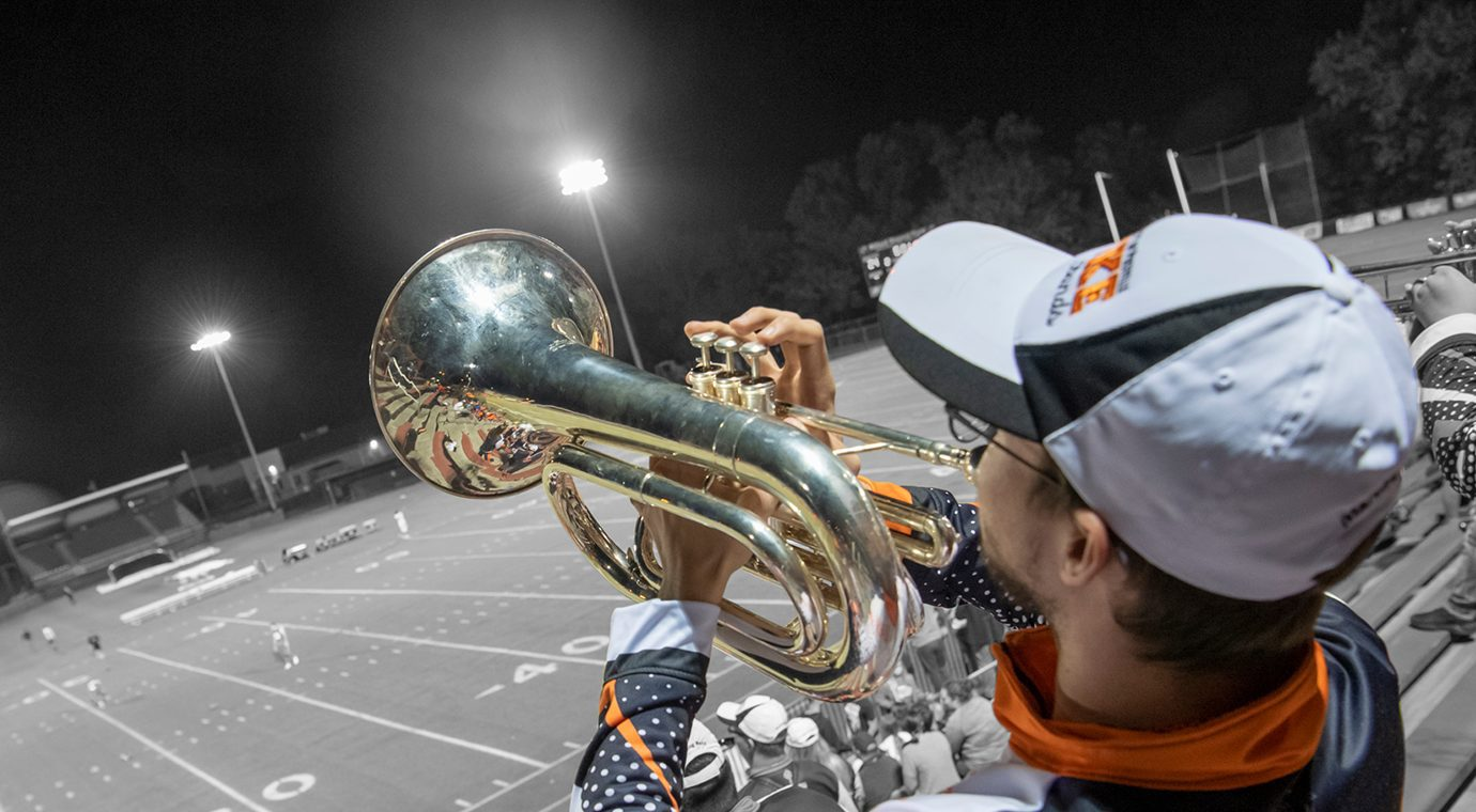 band student performing at football game