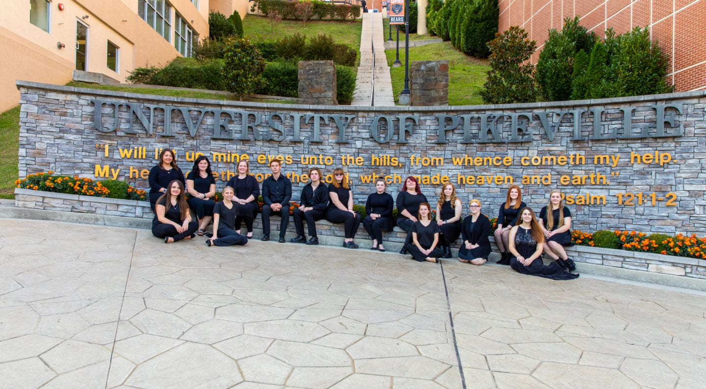 university choir in front of UPIKE sign