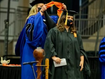 MSW graduate being hooded by UPIKE faculty