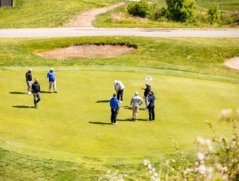 View of players on the golf course