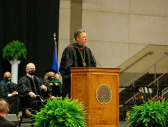 UPIKE President Webb speaking at Commencement