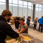Students at a table packaging meals