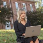 Student outside on a laptop