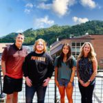 Wells Family and two UPIKE scholarship recipients
