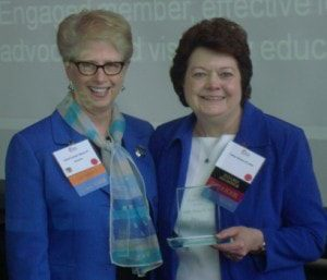 Dr. Cathy Hinton, right, receives the Carol Likens Award.