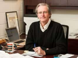 Associate Professor William A. Akers, Chair of the Motion Pictures program, at his desk