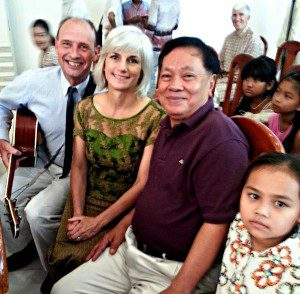 Taplin pictured here with her husband, Chaz, and Cambodian leaders.