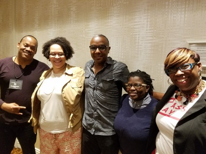 Speakers pose for a photo at a panel for the International Black Film Festival