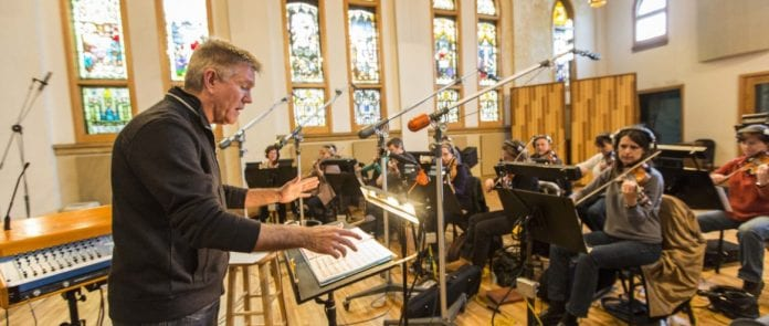 A conductor directs an orchestra for a recording in Ocean Way