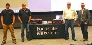Romano, Reynolds, Howell and Farkus standing by Focusrite equipment