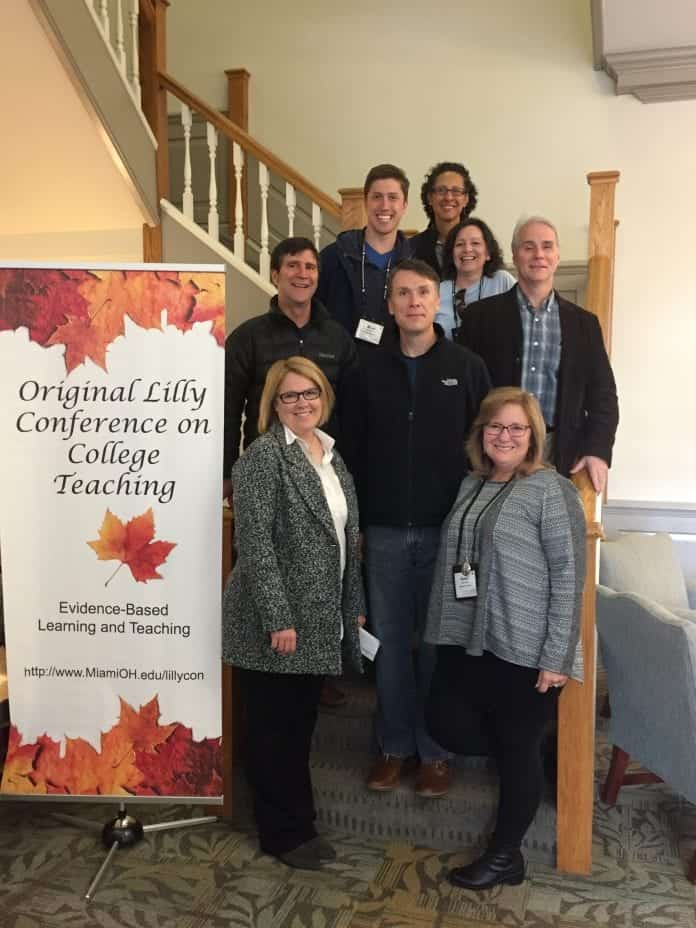Several Belmont faculty standing by the Lilly Conference on College Teaching Sign