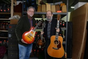"""George Gruhn and Doug Howard hold a 1923 Gibson F-5 Lloyd Loar mandolin, 1960 Les Paul Standard """"Burst"""" electric guitar and 1939 Martin D-45 acoustic guitar that have been donated to Belmont University at Gruhn Guitars in Nashville, Tenn. November 8, 2016."""