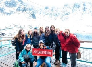 """Students holding a sign that says """"Belmont Abroad"""" in Switzerland"""